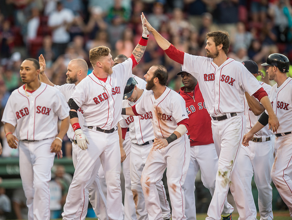 BOSTON, MA - JULY 10: Mike Carp #37 and Andrew Miller #30 of the Boston Red Sox celebrate a victory against Chicago White Sox with a high five at Fenway Park in Boston, Massachusetts on July 10, 2014. (Photo by Rob Tringali) *** Local Caption *** Mike Carp;Andrew Miller
