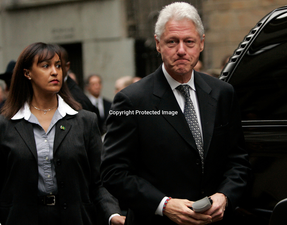 Former U.S. President Bill Clinton(R) leaves memorial services for Andrea Bronfman at the B'nai Jeshurun synagogue in New York January 25, 2006. Bronfman, wife of Charles Bronfman, heir to the Canadian Seagram's liquor empire, was struck and killed by a car on Monday. REUTERS/Keith Bedford