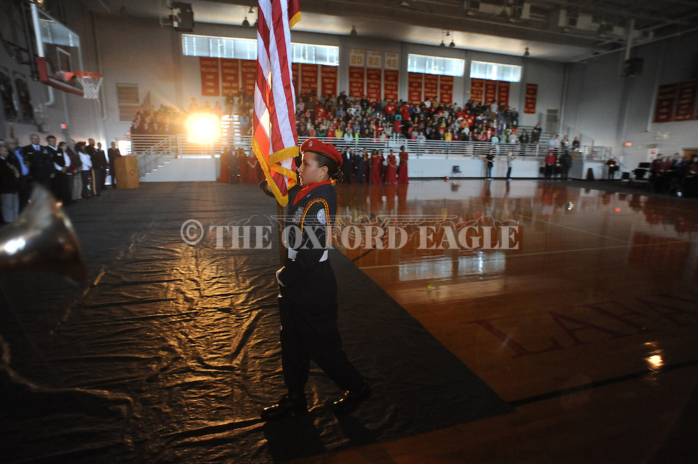 AFJROTC Cadet Courtney Conway retires the colors at the conclusion of a Veterans Day program at Lafayette High School in Oxford, Miss. on Thursday, November 7, 2013.
