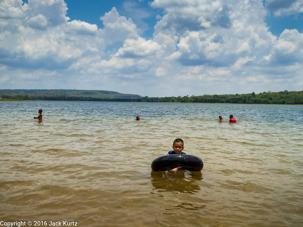 09 MAY 2016 - TA TUM, SURIN, THAILAND:    People swim in the reservoir behind Huai Khanad Mon Dam in Ta Tum, Surin, Thailand. The reservoir is almost out of water and is too low to water the agricultural fields around it. Thailand is in the midst of its worst drought in more than 50 years. The government has asked farmers to delay planting their rice until the rains start, which is expected to be in June. The drought is expected to cut Thai rice production and limit exports of Thai rice. The drought, caused by a very strong El Nino weather pattern is cutting production in the world's top three rice exporting countries:  India, Thailand and Vietnam. Rice prices in markets in Thailand and neighboring Cambodia are starting to creep up.     PHOTO BY JACK KURTZ