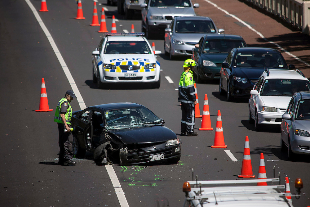 Serious Crash Unit investigate a two car crash on Tamaki Drive in Parnell which left a man seriously injuried and causing long traffic delays, Auckland, New Zealand, Friday, November 22, 2013. Credit:SNPA / Bradley Ambrose