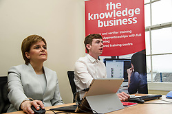 Pictured: First Minister Nicola Sturgeon sat in with student Adam Fisher for a session in IT<br /> <br /> Ahead of the Programme for Government, First Minister Nicola Sturgeon visited  IT company  Digital Net in Edinburgh.  DIgital Net use innovative digital training to upskill their young workforce. During the visit, Ms Sturgeon met modern apprentices taking part in a digital skills lesson in their dedicated digital skills classroom.<br /> <br /> Ger Harley: 5 September 2017
