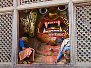"The big golden mask of Seto Bhairab (or White Demon) dates from 1794 in the time of Rana Bahadur Shah, the third king of the Shah Dynasty, in Durbar Square, Kathmandu, Nepal. Nepal Airlines uses this mask in their winged symbol. By the way, ""Royal Nepal Airlines"" dropped the ""Royal"" word in 2006, to be consistent with Nepal's interim parliament rejecting the Monarchy. In Newar mythology, Seto Bhairab showed disrespect towards the important goddess Mahakali, tempting her terrible retribution. When Seto Bhairab later offered a cock as an offering of respect, Mahakali first refused the rooster, then suddenly bit the head off as a bloody warning to Seto Bhairab: ""Don't upset the hierarchy of the gods"". For ten days once a year during the Indra Jatra festival (and the coinciding festival of the Living Goddess) in September, this Seto Bhairab mask is uncaged, and devotees shower him with rice and flower petals, while rice beer is poured through his fearsomely fanged mouth. Men struggle with each other to drink from the sacred brew, which is blessed by the rain god Indra, the ancient Vedic god who came with the Aryan forefathers from Persia to India, many centuries before Christ. The rest of the year, terrifying Seto Bhairab is kept safely caged behind a wooden grille,  on the Deotali Mandir royal temple. Published in ""Light Travel: Photography on the Go"" book by Tom Dempsey 2009, 2010."