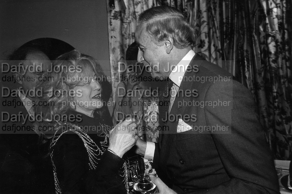 David Ashton-Bostock and Princess Ali Alia Khan (fake) at Townhouse Interiors 4/3/1986 ONE TIME USE ONLY - DO NOT ARCHIVE  © Copyright Photograph by Dafydd Jones 66 Stockwell Park Rd. London SW9 0DA Tel 020 7733 0108 www.dafjones.com