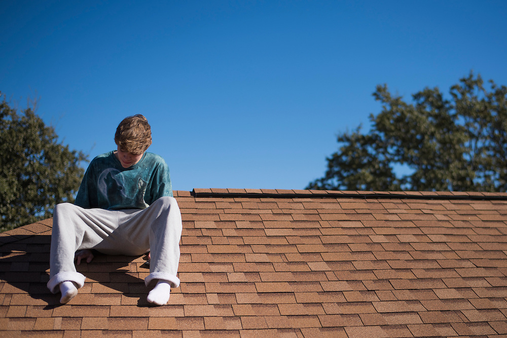 Christian Akridge hangs out on his roof at his home in Wichita Falls, Texas on November 18, 2015.  (Cooper Neill for Rolling Stone)