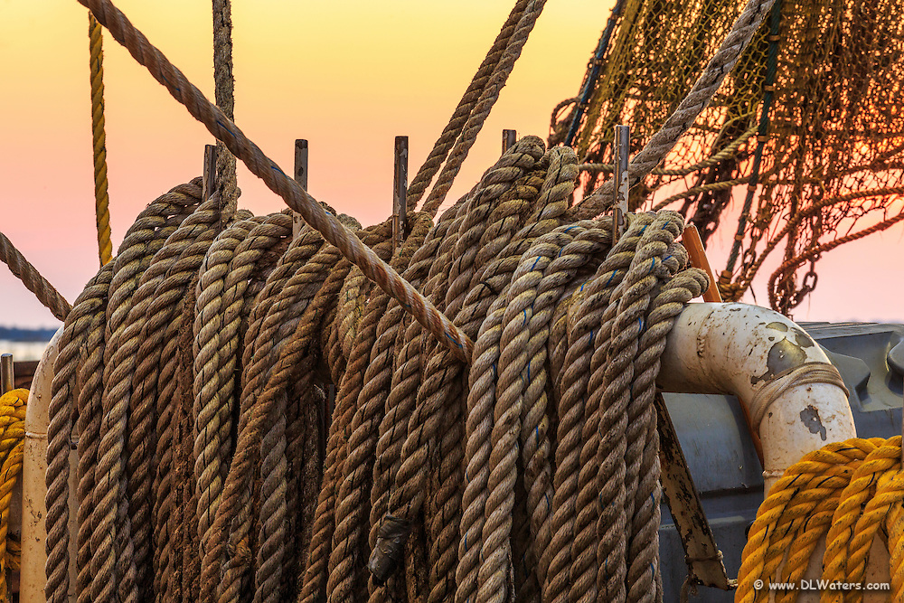 Lines and net on a Wancheese fishing boat at sunrise.