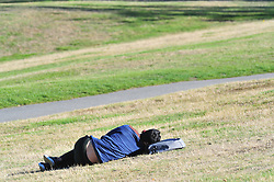 © Licensed to London News Pictures. 09/10/2018<br /> GREENWICH, UK.<br /> Man takes a nap in the sun.<br /> People out and about in an autumnal Greenwich Park on a sunny October day in London and the South East with temperatures at 19C with blue sky. <br /> Photo credit: Grant Falvey/LNP