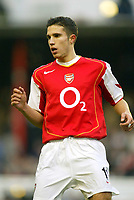 16/10/2004<br />FA Barclays Premiership - Arsenal v Aston Villa - HIghbury<br />Arsenal's Robin Van Persie makes his debut whilst on a police charge of fleeing the scene of the crime after he crashed his BMW and left it in a field.<br />Photo:Jed Leicester/BPI (back page images)