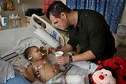 At Stanford Children's Hospital, Ryan Jeffers feeds Malyia ice chips to sooth her.