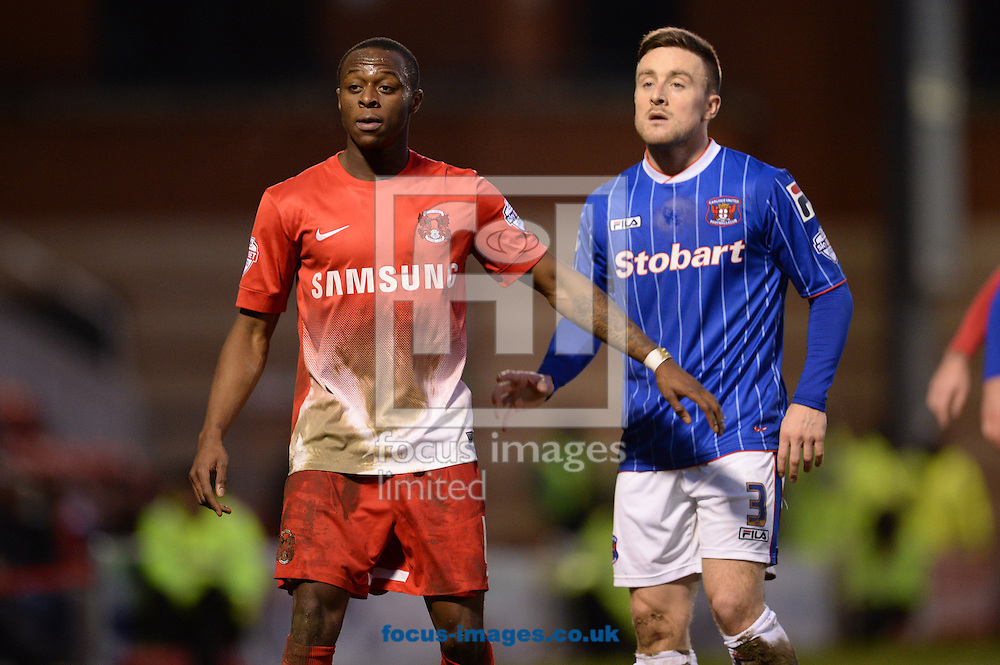 Picture by Andrew Timms/Focus Images Ltd +44 7917 236526<br /> 11/01/2014<br /> Moses Odubajo of Leyton Orient and Matty Robson of Carlisle United during the Sky Bet League 1 match at the Matchroom Stadium, London.