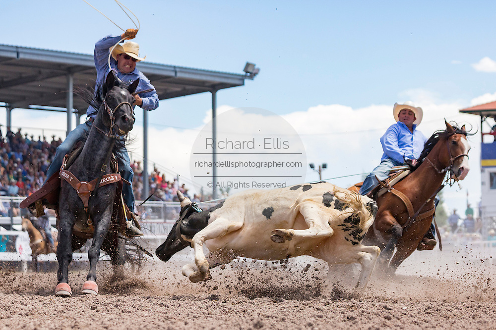 Team Roper Terry Shaffer and Lance Allen during the Team Roping finals at the Cheyenne Frontier Days rodeo in Frontier Park Arena July 26, 2015 in Cheyenne, Wyoming.