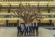 Sir Nicholas Serota, Lord Browne, Frances Morris, Sadiq Khan, Ed Vaizey, Kerstin Mogull, Jacques Herzog, Pierre de Meuron in the Turbine Hall with Ai Weiwei?s 7-metre high sculpture of a tree - The new Tate Modern will open to the public on Friday 17 June. The new Switch House building is designed by architects Herzog & de Meuron, who also designed the original conversion of the Bankside Power Station in 2000.