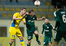 Luka Zinko of NK Domzale vs Marko Puklin of Krka during football match between NK Domzale and NK Krka in Semifinal of Slovenian Football Cup 2016/17, on April 4, 2017 in Sports park Domzale, Slovenia. Photo by Vid Ponikvar / Sportida