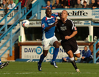Photo: Ian Hebden.<br />Chesterfield United v Swansea City. Coca Cola League 1. 14/10/2006.<br />Swanseas Lee Trundle (R) tangles with Chesterfields Reuben Hazell (L).