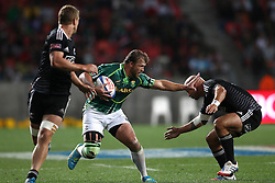 Frankie Horne of South Africa attempts to hand off DJ Forbes of New Zealand during the Cup Final match between South Africa and New Zealand on Day 2 of the HSBC Sevens World Series Port Elizabeth Leg held at the Nelson Mandela Bay Stadium on 8th December 2013 in Port Elizabeth, South Africa. Photo by Shaun Roy/Sportzpics