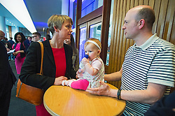 © London News Pictures. 16/05/2015. Yvette Copper meets 6 month old Betsie and her father as she arrives at Progress Annual Conference held at TUC Congress House in London to discuss the labour leadership race following a heavy defeat in the recent general election..  Photo credit: Ben Cawthra/LNP