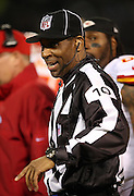 Line judge Julian Mapp (10) smiles during the against the Oakland Raiders NFL week 12 regular season football game against the Kansas City Chiefs on Thursday, Nov. 20, 2014 in Oakland, Calif. The Raiders won their first game of the season 24-20. ©Paul Anthony Spinelli