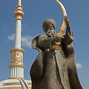 Statue of Seljuk Beg in front of monument at Independence Park, Ashgabat, Turkmenistan