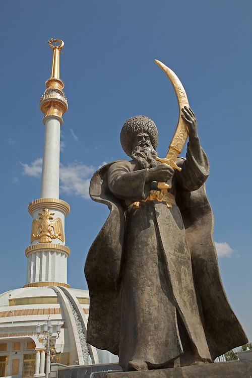Statue of Seljuk Beg in front of monument at Independence Park, Ashgabat, Turkmenistan