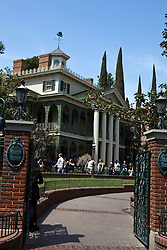 Gates open to the Haunted Mansion attraction at Disneyland Resort, Anaheim, California, United States of America.