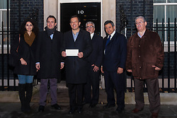 London, Novemeber 15th 2014. A delegation of Greek Cypriots deliver a petition to Downing Street demanding the the UK pressures Turkey into ending its occupation of the Island, which has been ongoing for 40 years.