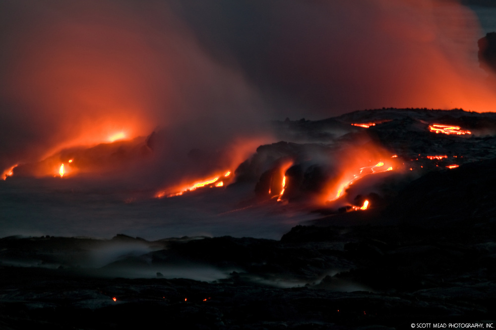 Flowing lava into ocean, creating steam cloud, Kilauea Volcano, Big Island, Hawaii