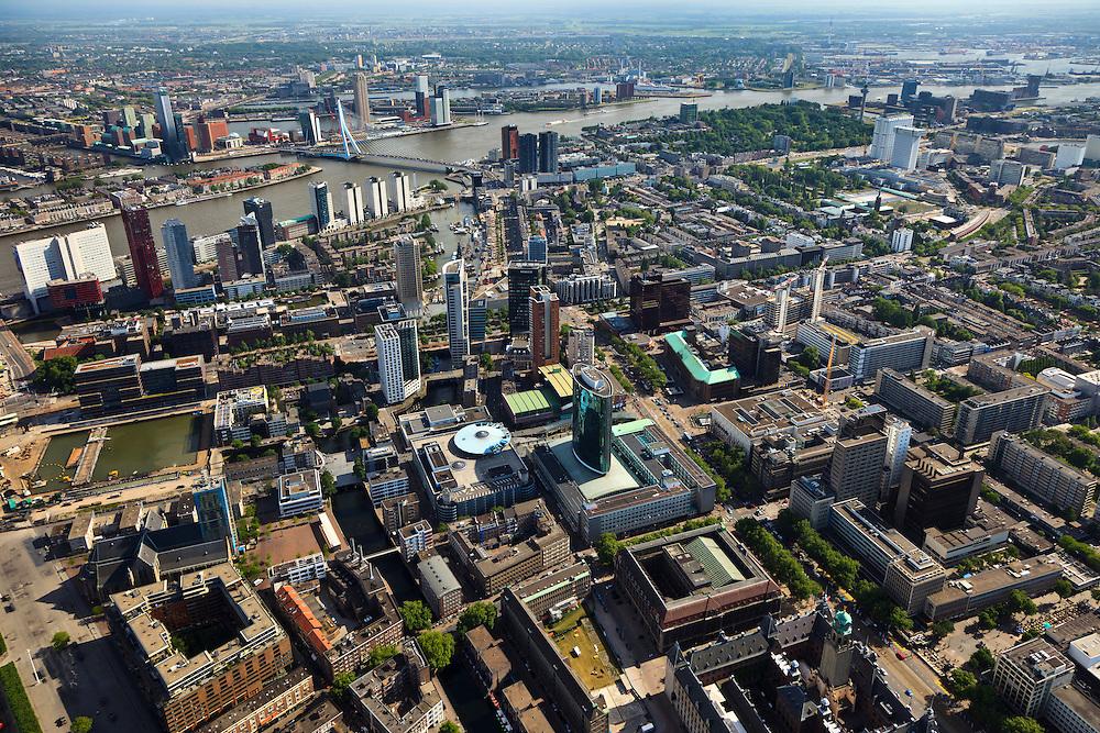 Nederland, Zuid-Holland, Rotterdam, 23-05-2011;.Zicht op Rotterdam in zuidelijke richting, met de Erasmusbrug over de Nieuwe Maas, het Noorderleiand (linksboven) en Het park aan deze over (rechtsboven). Links aan het water het witte gebouw van Nedlloyd. Coolsingel en Beursplein Rotterdam. Groene ovalen gebouw is Beurs - World Trade Center, rechts daarvan de Bijenkorf en tegenover het kopergroenel dak van de ABN_AMRO, erachter de nieuwbouw. Midden boven het haventje van het Maritiem Museum aan de Leuvehaven met historische boten..View on Rotterdam in south drection, the Erasmusbrug over the river Nieuwe Maas, the cultural district the Kop van Zuid en the south part of Rotterdam..Green oval building is Beurs - World Trade Center, on the right  the shopping building Bijenkorf and the green copper roof of the ABN_AMRO, new building next to it. Top left the harbor of the Maritime Museum with historic boats..uchtfoto (toeslag), aerial photo (additional fee required).copyright foto/photo Siebe Swart
