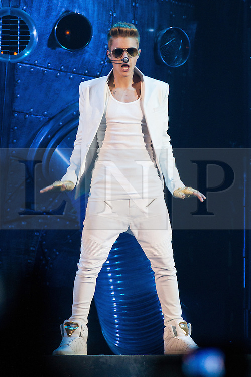 """© Licensed to London News Pictures . FILE PICTURE DATED 21/02/2013 of Canadian pop star JUSTIN BIEBER performing on stage at the Manchester Arena , UK , on the opening night of his UK """" Believe """" tour , as a spokeswoman last night (7th March) reported Bieber had to take an unscheduled break during a show at the O2 Arena last night (7th March). Bieber was said to have fainted and had to be treated by doctors with oxygen before returning to the stage . Photo credit : Joel Goodman/LNP"""
