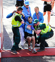An athlete receives medical attention<br /> The Virgin Money London Marathon 2014<br /> 13 April 2014<br /> Photo: Javier Garcia/Virgin Money London Marathon<br /> media@london-marathon.co.uk