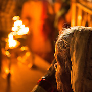 An elderly woman watches the aarti celebration at Parmarth Niketan Ashram, Rishikesh, India.