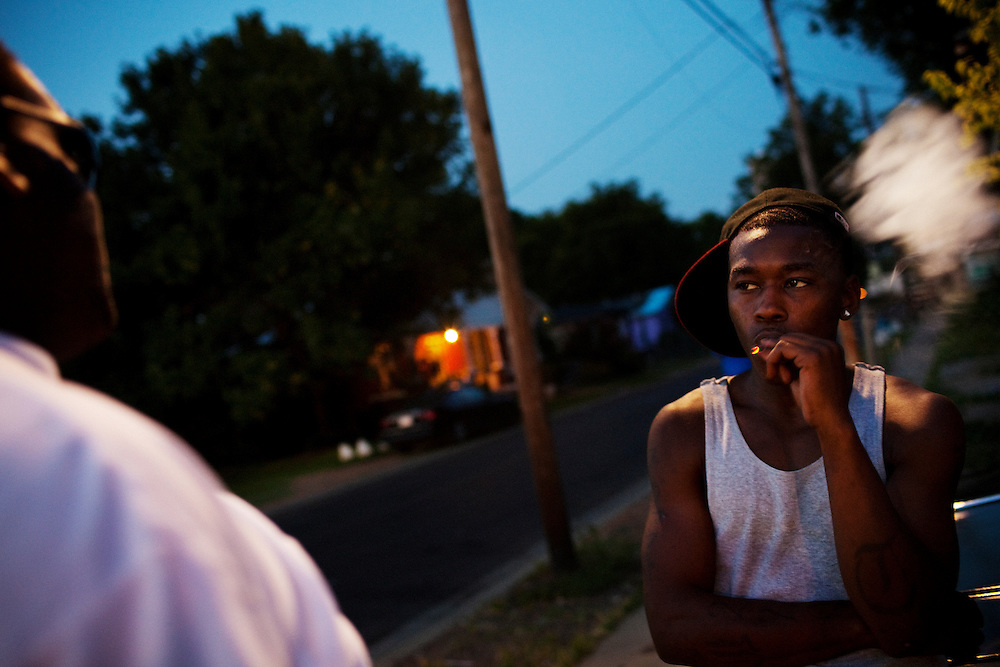 A young male smokes a cigarette in the Baptist Town neighborhood of Greenwood, Mississippi on Friday, July 2, 2010.