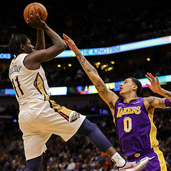 Mar 22, 2018; New Orleans, LA, USA; New Orleans Pelicans guard Jrue Holiday (11) shoots over Los Angeles Lakers forward Kyle Kuzma (0) during the second half at the Smoothie King Center. The Pelicans defeated the Lakers 128-125. Mandatory Credit: Derick E. Hingle-USA TODAY Sports