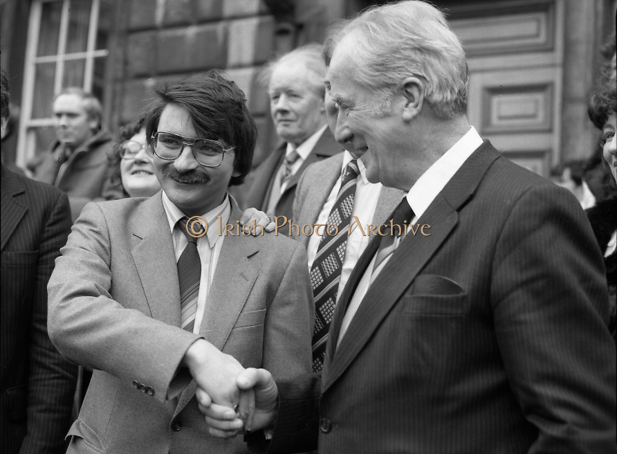 TDs arrive for the opening session of the 23rd Dáil...9-03-82.03-09-1982.9th March 1982..Pictured At Leinster House. ..Limerick City Fianna Fáil TD Willie O'Dea bing congratulated by Clare Galway South Fianna Fáil TD Dr Bill Loughnane