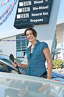 Portrait of smiling woman at natural gas station
