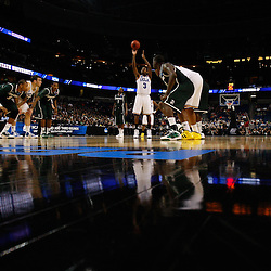 Mar 17, 2011; Tampa, FL, USA; UCLA Bruins guard Malcolm Lee (3) shoots a free throw during the second half of the second round of the 2011 NCAA men's basketball tournament against the Michigan State Spartans at the St. Pete Times Forum. UCLA defeated Michigan State 78-76.  Mandatory Credit: Derick E. Hingle