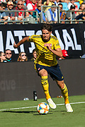 Arsenal defender Carl Jenkinson (25) brings the ball up the pitch during an International Champions Cup game, Saturday, July 20, 2010, in Charlotte, NC. Arsenal defeated Fiorentina 3-0. (Brian Villanueva/Image of Sport)