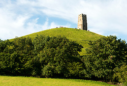 © Licensed to London News Pictures; 21/06/2020; Glastonbury, Somerset, UK. General views of Glastonbury Tor as the morning brightens up on the Sunday of Solstice weekend after a night with some heavy rain and though low cloud and mist obscured the sunrise. This year due to the coronavirus Covid-19 pandemic and concerns over social distancing at gatherings of people, Stonehenge and Avebury where thousands of people usually gather to celebrate the summer solstice are closed to the public, with the solstice live streamed from Stonehenge. Glastonbury authorities had also asked people to refrain from coming to Glastonbury for the solstice but hundreds came with many staying the night on the Tor. Glastonbury Tor is a hill outside Glastonbury town, topped by the roofless St Michael's Tower, a Grade I listed building which is what remains of the Church of St Michael built in the 14th century. The entire site is managed by the National Trust and has been designated a scheduled monument. Photo credit: Simon Chapman/LNP.