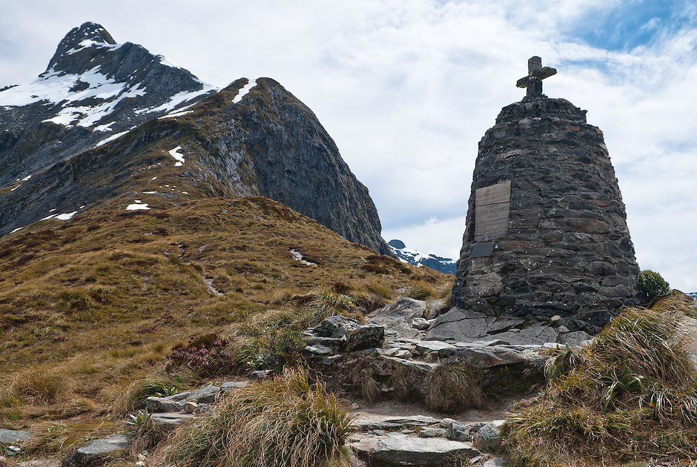 Mount Hart overlooks the monument to Quintin McKinnon, marking the top of New Zealand's Milford Track ascent to Mackinnon Pass