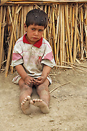 Marshland Arab boy in Maysan Province living in abject poverty with his nomad family