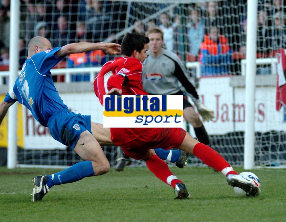 Photo: Ian Hebden.<br />Rushden & Diamonds v Grimsby Town. Coca Cola League 2. 04/03/2006.<br />Rushden skipper Rob Gier (R) gets a shot in before Grimsbys Robert Jones (L) blocks.