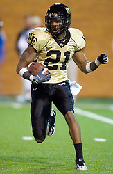 Wake Forest wide receiver Andrew Wright (21) returns a UVA kick.  The Wake Forest Demon Deacons defeated the Virginia Cavaliers 24-17 in NCAA Division 1 Football at BB&T Field on the campus of Wake Forest University in Winston-Salem, North Carolina on November 8, 2008.
