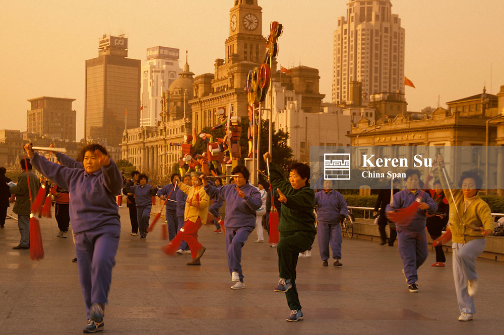 People practicing Taichi with sword on the Bund in early morning, Shanghai, China