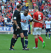Neil Danns is yellow carded during the Sky Bet Championship match between Bolton Wanderers and Nottingham Forest at the Macron Stadium, Bolton, England on 22 August 2015. Photo by Mark Pollitt.