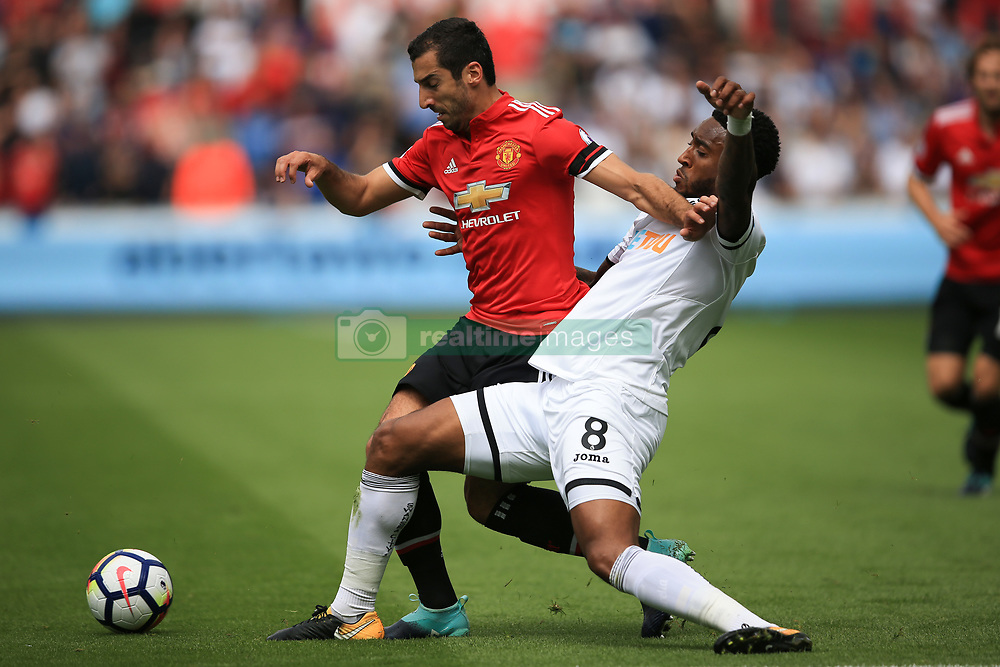 19 August 2017 -  Premier League - Swansea City v Manchester United - Henrikh Mkhitaryan of Manchester United tangles with Leroy Fer of Swansea City - Photo: Marc Atkins/Offside