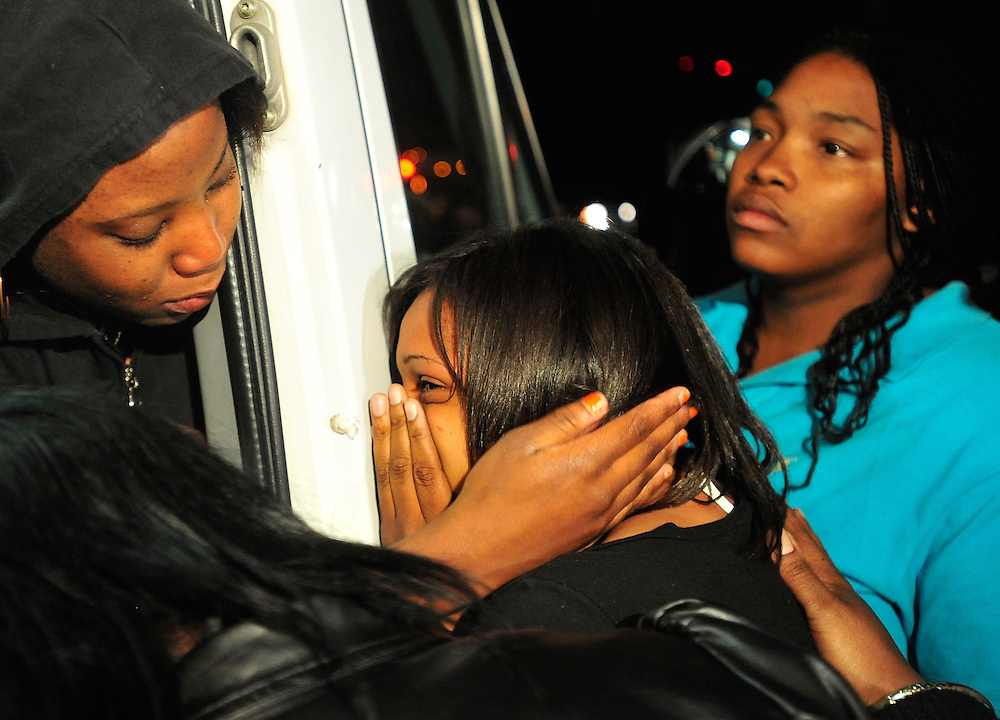 "A friend comforts Jennifer Hood, center, the sister of alleged gunman Jamie Hood, as they watch from the back of a news van as Jamie Hood surrenders to the police after a four day manhunt on Friday, March 25, 2011 in Athens, Ga.  Jamie Hunt is accused of murdering Athens-Clarke Senior Police Officer Elmer ""Buddy"" Christian and wounding Senior Police Officer Tony Howard.   (Richard Hamm/Staff/richard.hamm@onlineathens)."
