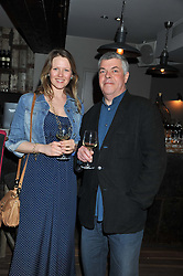 SIMON HOPKINSON and ALICE HART at a party to celebrate the publication of A History of Food in 100 Recipes by William Sitwell held at Archer street, 3-4 Archer Street, London W1 on 11th April 2012.