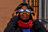 Roma 20 Marzo 2015<br /> Eclissi solare parziale al quartiere San Lorenzo. La gente si riunita questa mattina in Piazza Immacolata, per osservare  l'eclissi solare parziale. Una donna  guarda l'eclissi solare parziale  attraverso gli occhiali da sole speciali di protezione<br /> <br /> Rome March 20, 2015<br /> Partial solar eclipse. People gather this morning in Piazza Immacolata, District San Lorenzo, to get a rare glimpse of the solar eclipse. A woman watch the partial solar eclipse, through special protective sunglasses.<br /> .