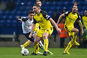 Burton Albion defender Jake Buxton in action during the EFL Sky Bet League 1 match between Bolton Wanderers and Burton Albion at the University of  Bolton Stadium, Bolton, England on 1 January 2020.