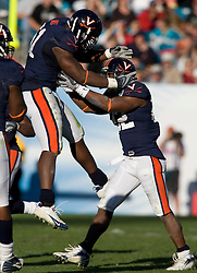 Virginia linebacker Clint Sintim (51) congratulates Virginia safety Byron Glaspy (22) after he recovered a fumble in the second half of the Gator Bowl.  The Texas Tech Red Raiders defeated the Virginia Cavaliers 31-28 in the 2008 Konica Menolta Gator Bowl held at the Jacksonville Municipal Stadium in Jacksonville, FL on January 1, 2008.