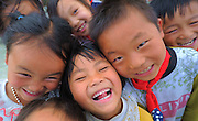 QIANNAN, CHINA - MAY 31: (CHINA OUT) <br /> <br /> Six-pupil School In Mountain Of Qiannan<br /> <br /> Pupils look at camera on May 31, 2016 in Qiannan Buyei and Miao Autonomous Prefecture, Guizhou Province of China. Gugang primary school with only one teacher and six students was located in the mountain where the traffic was blocked in Qiannan. 50-year-old Wu Guoxian had been teaching in this school for 33 years and taught over 1,000 students. More and more people went out of the village to work in the cities leaving their children and the old in the mountain. Five under-school-age kids whose parents left for work also stayed at the school.<br /> ©Exclusivepix Media